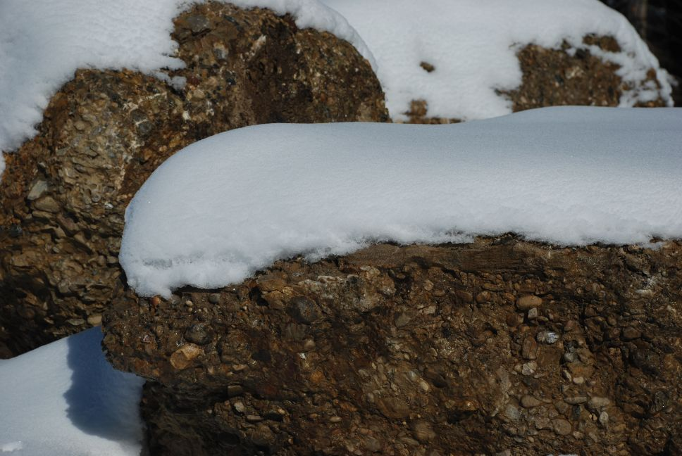 Nagelfluh rocks covered in snow